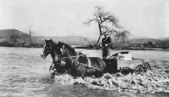 Joe Foster fording the swollen San Diego River. c.1916